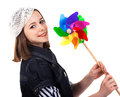 Young cute brunette girl with wind turbine toy Royalty Free Stock Photography