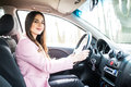 Young cute brunette woman driving a car. Royalty Free Stock Photo
