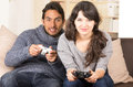 Young cute couple playing video games