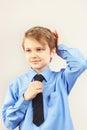 Young cute gentleman straighten tie over bright shirt
