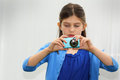 Young cute little girl photographer taking picture her point shoot digital camera copy space shallow depth field Royalty Free Stock Image