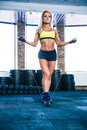 Young cute sporty woman workout with jumping rope Royalty Free Stock Photo