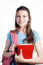 Young cute teenage girl posing cheerful against white background with books and backpack isolated Stock Photos