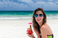 Young cute woman with fresh cocktail at tropical sandy beach Royalty Free Stock Photo