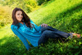Young cute woman resting on green fresh grass Royalty Free Stock Images