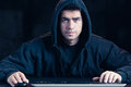 Young cyber warior in hoody photo of black Stock Image