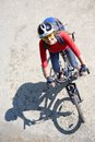 Young cyclist traveling on a mountain bike in the park Stock Images