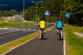 Young cyclists girl and boy biking on cycle lane Royalty Free Stock Image