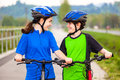 Young cyclists girl and boy biking on cycle lane Royalty Free Stock Images