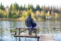 Young dad and little girl fishing on the lake Royalty Free Stock Photo