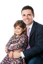Young dad with little girl on lap close up portrait of attractive businessman in suit his daughter isolated white background Stock Photo