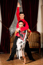 Young dance couple preforming latin show dance in ancient ballro Royalty Free Stock Photo