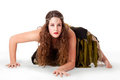Young dancer crouching in fairy-inspired costume Stock Photo