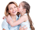 Young daughter kissing mother isolated happy family people concept Royalty Free Stock Photo