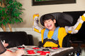 Young disabled boy in wheelchair playing checkers Royalty Free Stock Photo