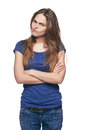 Young discontent girl with folded hands Royalty Free Stock Photo