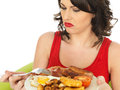Young Disgusted Woman Eating a Full English Breakfast Royalty Free Stock Photo