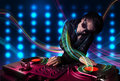 Young Dj mixing records with colorful lights Stock Photography