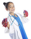 Young doctor with heart a pretty elementary displaying two opposing halves of a model on a white background Royalty Free Stock Photography