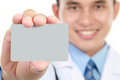Young doctor holding business blank card Stock Image
