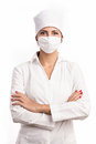 Young doctor standing with arms folded over white Royalty Free Stock Photo