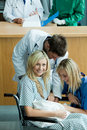 Young doctors attending a patient with a baby Royalty Free Stock Photo