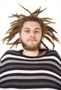 Young dreadlock man lies isolated Royalty Free Stock Photo