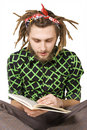 Young dreadlock man reading book isolated Royalty Free Stock Photo