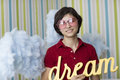 Young dreamer in pink glasses teenager is looking through Royalty Free Stock Images