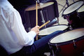 Young drummer plays the drum set. Royalty Free Stock Photo