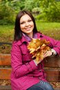 Young elegant woman with autumn leaves Stock Photo