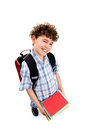 Young elementary student kid with backpack standing isolated on white background Royalty Free Stock Image