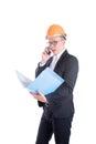 Young engineer man wearing orange helmet talking via mobile phone Royalty Free Stock Photo