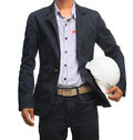 Young engineering man and safety helmet isolated white Royalty Free Stock Photo