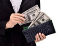 Young entrepreneurs insert a lot of dollars in the wallet isolated on white background Stock Images