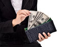 Young entrepreneurs take a lot of dollars in the wallet isolated on white background Stock Photo