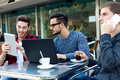 Young entrepreneurs working at coffee bar. Royalty Free Stock Photo