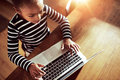 Young ethnic black girl typing on a laptop Royalty Free Stock Photo