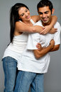 Young ethnic couple in blue jeans Royalty Free Stock Photo