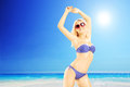 Young excited female in bikini enjoying on a sunny day beach Royalty Free Stock Images