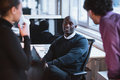 Young executives at work image of afro american men sitting desk in office Royalty Free Stock Photography