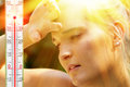 Young exhausted woman on a hot day Stock Photo