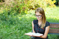 Young fair-haired woman reading Royalty Free Stock Images