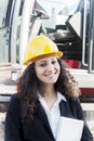 Young famale architect at work on site smiling with yellow helmet Royalty Free Stock Photos
