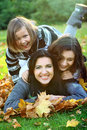 Young family in autumn park Royalty Free Stock Photos