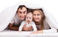 Young family with baby boy under blanket Royalty Free Stock Photo
