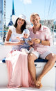 Young family with a baby on a sailing boat Royalty Free Stock Photo