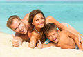 Young family at the beach happy with little kid having fun Royalty Free Stock Photo