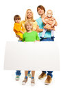 Young family with blank advertising banner portrait of a standing isolated on white mother father little boys and baby girl Stock Image