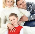 Young family with a child at home attractive Royalty Free Stock Photo